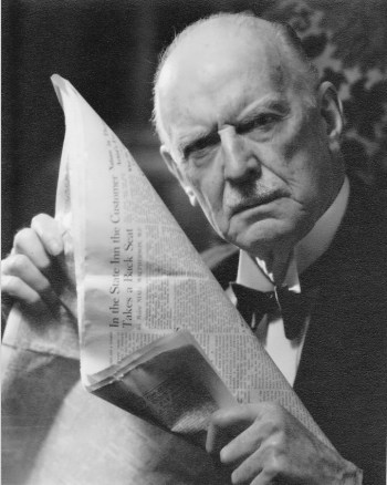 Man with paper 1950s England