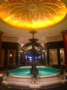 A beautiful reception area includes amazing fountain.
