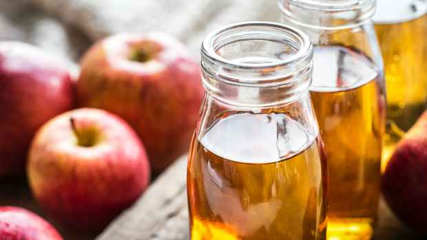clear glass mason bottles with apple juice
