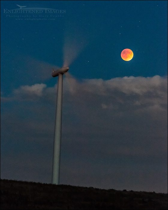 Photo: Super-Blood-Harvest Moon during a Lunar Eclipse next to wind turbine, Solano County, California September 27, 2015