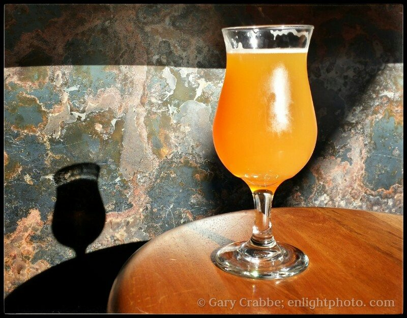A cold glass of IPA beer sitting in the sunlight at the Hop Grenade, Concord, California