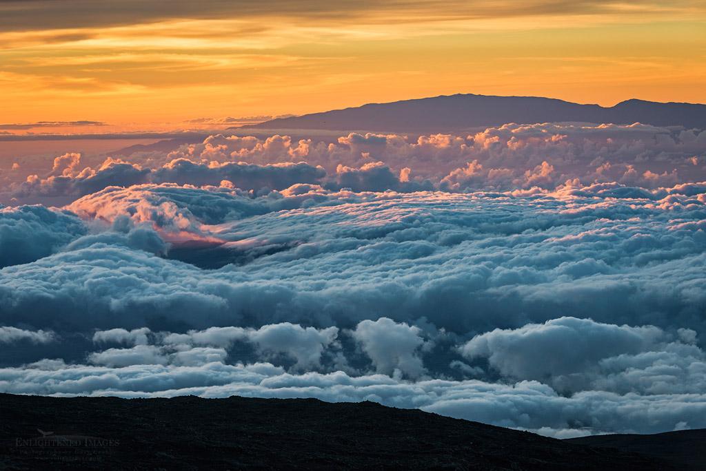 Photo: Sea of clouds at sunset seen from the summit of Mauna Kea, (looking toward Haleakala on neighboring island of Maui, Big Island of Hawai'i, Hawaii