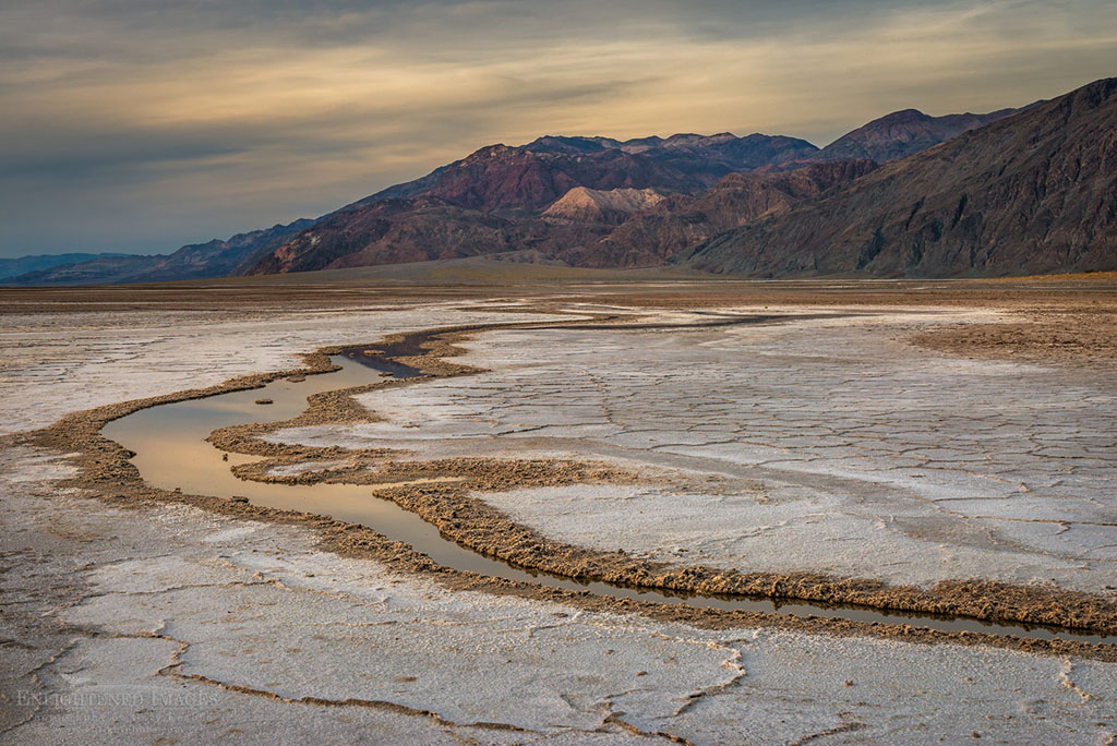Stream running through the salt flats in the Badwater Playa, Death Valley National Park, California