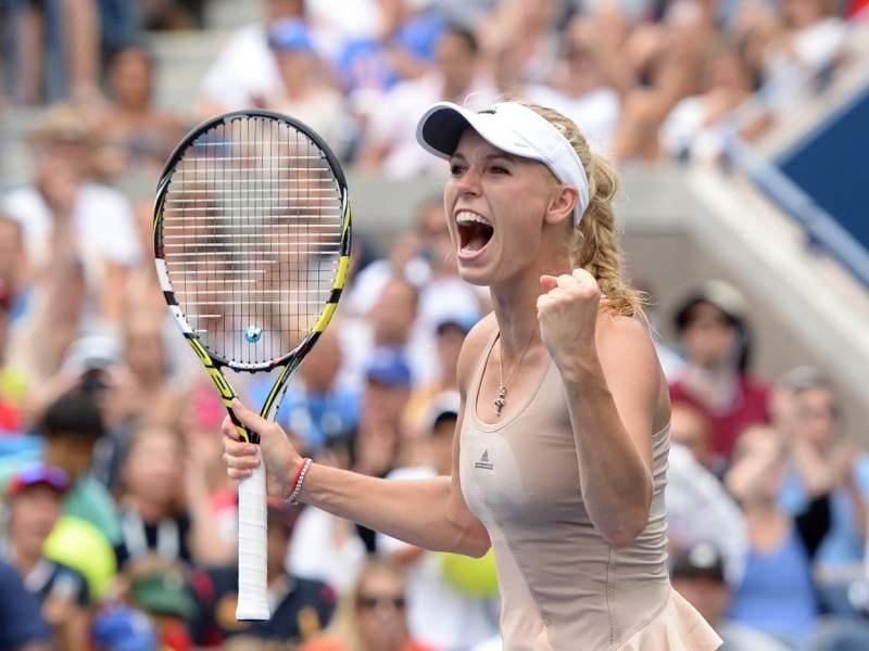 Wozniacki celebra su pase a cuartos de final tras imponerse a Sharapova.