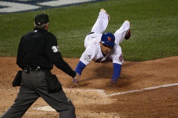 El dominicano  Juan Lagares marcó la sexta carrera de los Mets gracias a un sencillo de su compatriota Juan Uribe.