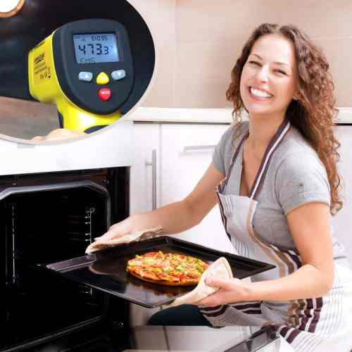 woman baking pizza with ennoLogic IR thermometer measuring temperature of pizza stone