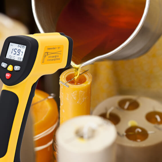 Measuring beeswax temperature with the ennoLogic non-contact thermometer when making candles.