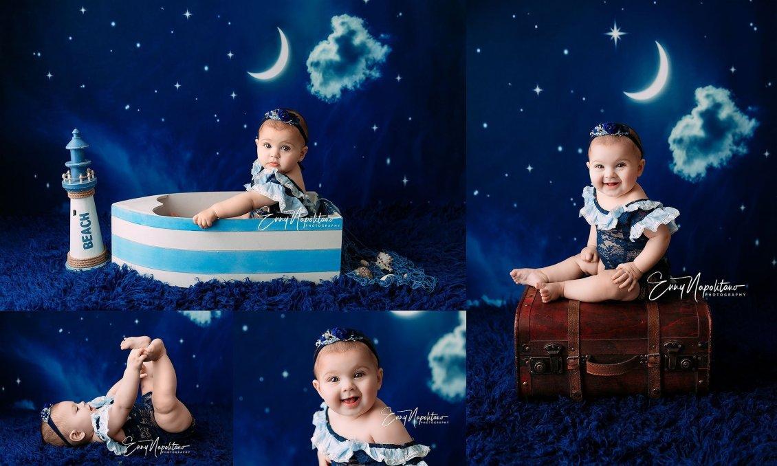 Fotografie di una bambina in una barca e sopra una valigetta in uno studio fotografico per bambini a Milano, Pavia, Monza, Bergamo, Varese fotografo di bambini Milano