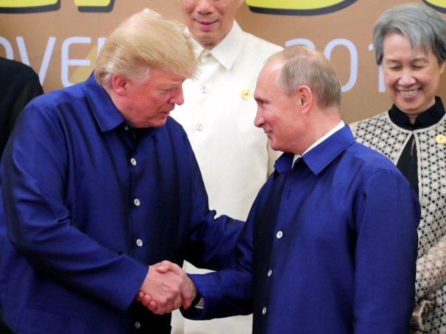 AAAAAAAAAAAAAAAAAAAAAwith-their-resplendently-blue-shirts-now-in-full-view-the-two-leaders-continued-to-shake-hands-and-chatted-briefly