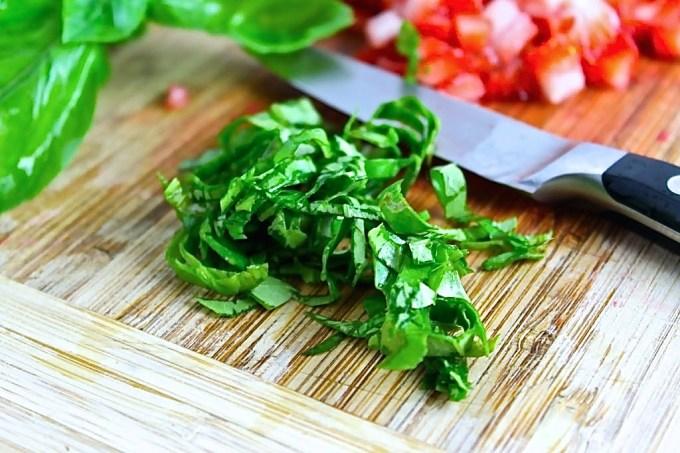 chopped basil to make Chèvre, Strawberry and Basil Bruschetta