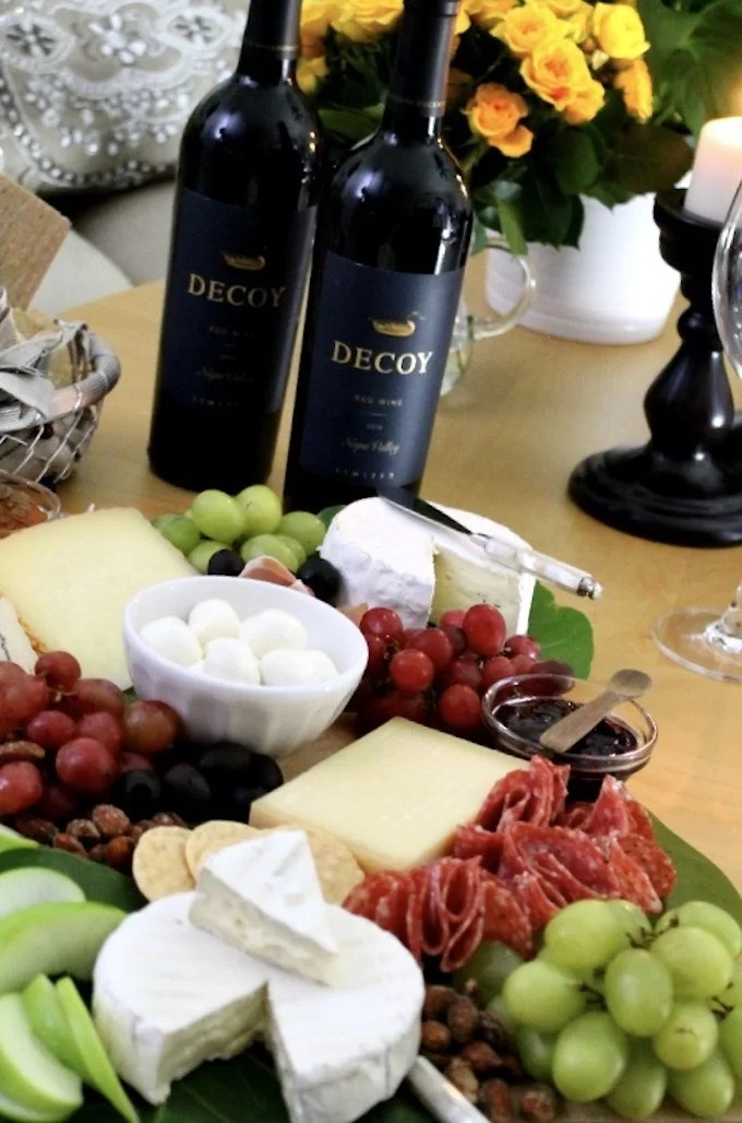 cheeseboard ready to be enjoy with a bottles of wine