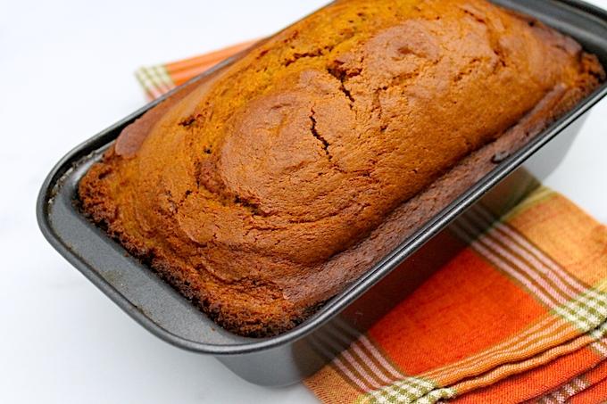 Pumpkin spice bread in a loaf pan.