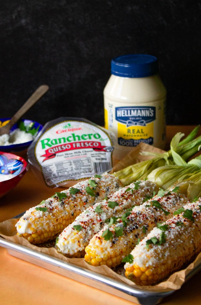 Mexican-style corn on the corn on the cob plus the ingredients to make it