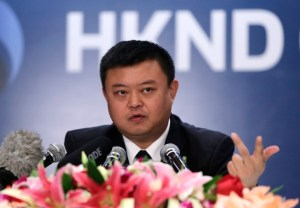 Wang, HKND Group chairman, answers a question at a news conference in Beijing