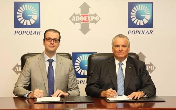 De izquierda a derecha, los señores Álvaro Sousa, presidente de AdoExpo y Luis E. Espínola, vicepresidente ejecutivo de Negocios Internacionales y Banca Privada del Banco Popular Dominicano.