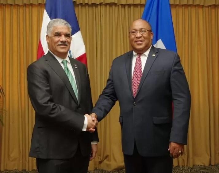 Miguel y Canciller haitiano