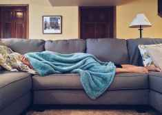 Person sick from dizziness of sofa