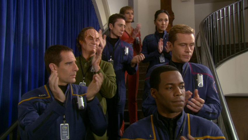 The Enterprise crew applauding Samuels' speech.