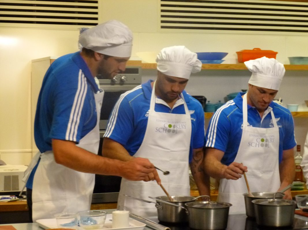 Rugby players taking part in chef course Scotland at The Edinburgh New Town Cookery School