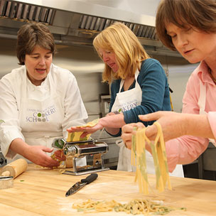 Learning how to make food from scratch during cookery class at culinary school Edinburgh