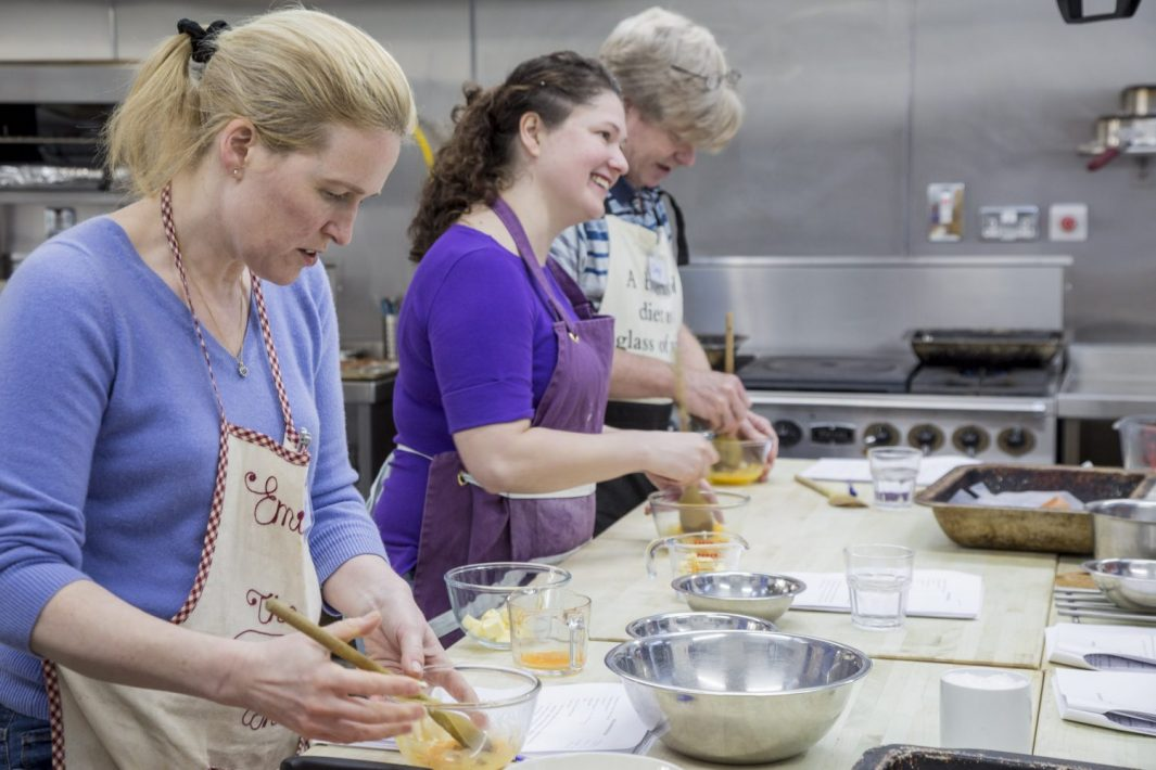 Edinburgh New Town Cookery School students learning culinary skills.