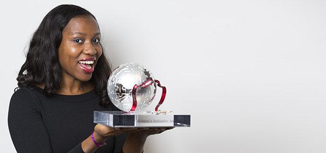 Bilikiss Adebiyi-Abiola carrying a Cartier Initiative Award Plaque
