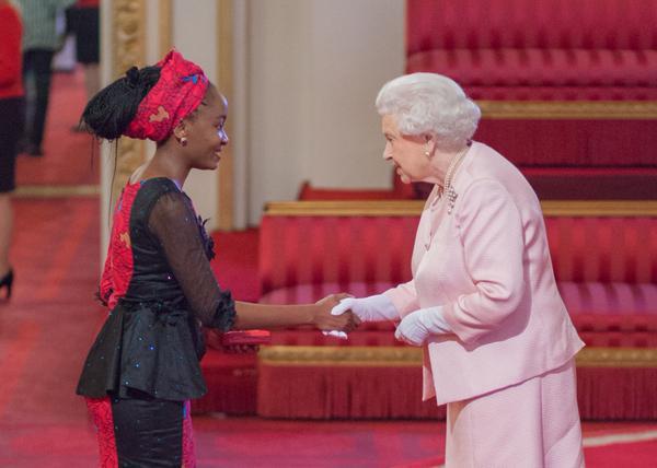 Nkechi Azinge of RAI being honoured by Queen Elizabeth