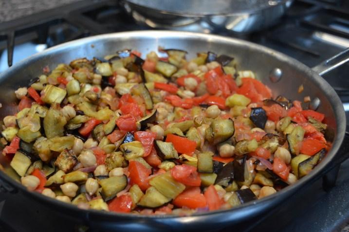 Sauté the eggplant, tomato and chickpeas