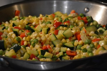 Add the corn and peas
