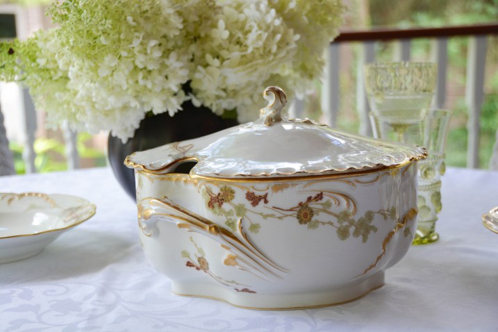 One side of the tureen showing the opening for the ladle