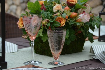 The roses tones of the glasses echoed the flowers