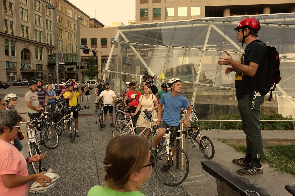 Cyclists listen to a talk during last year's Future of Downtown Bike Infrastructure Ride in downtown Pittsburgh.