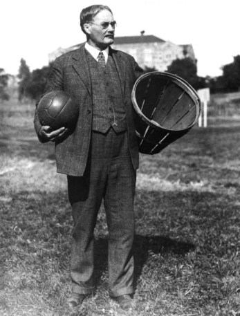 James Naismith with an early basketball (actually, a soccer ball) and a basket (literally) into which it should be shot.
