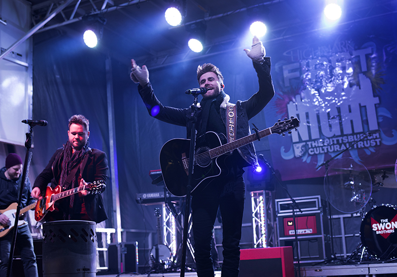 """Colton Swon (R) greets fans as he and brother Zach begin their set as the headline act for First Night. The duo were finalists on NBC's """"The Voice."""""""