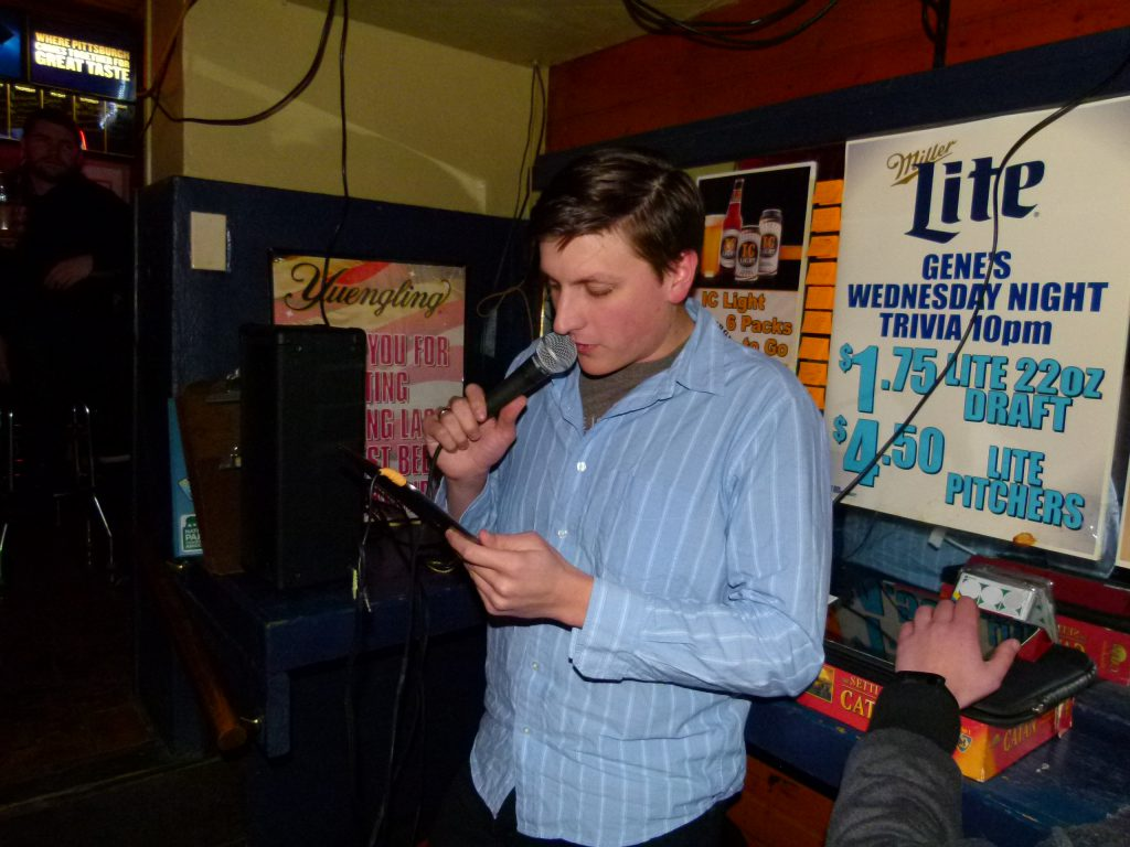 """Co-host Mike """"Marty"""" Stanis calls out a round one question at Gene's Place Trivia Night."""