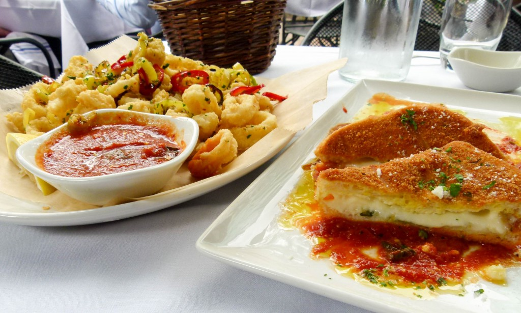 "mozzarella in carrozza (r.) and calamari arrabiata style (l.) allow for an alliterative and delicious pairing of antipastos. Carrozza means ""carriage"" in Italian. In this case, the ""carriages"" are filled with mozzarella."