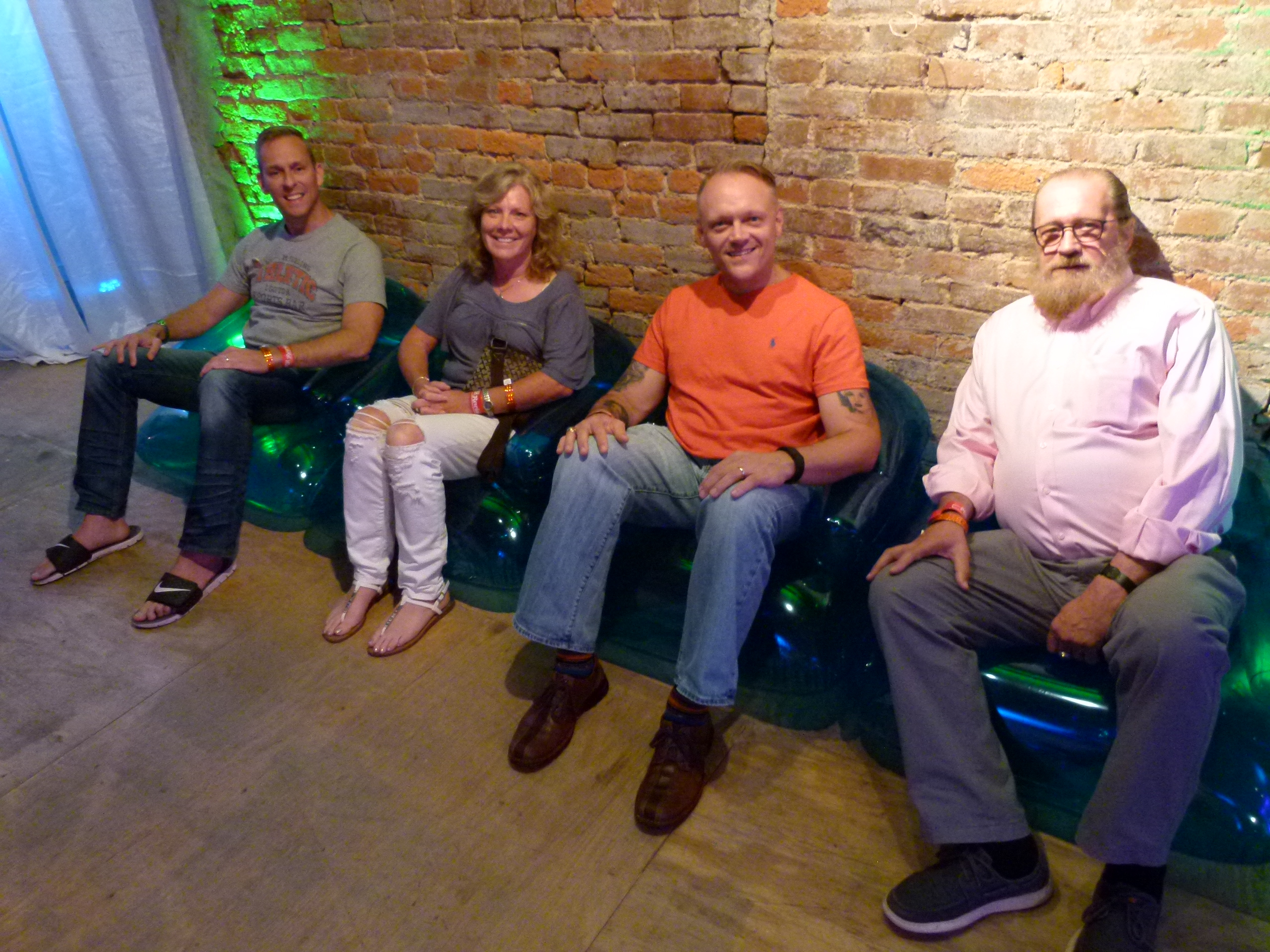 Guests relaxing on blue bubble chairs: (l. to r.) Eric Horwith, Chris Schuette, John Komisary, and Dennis Wilson.