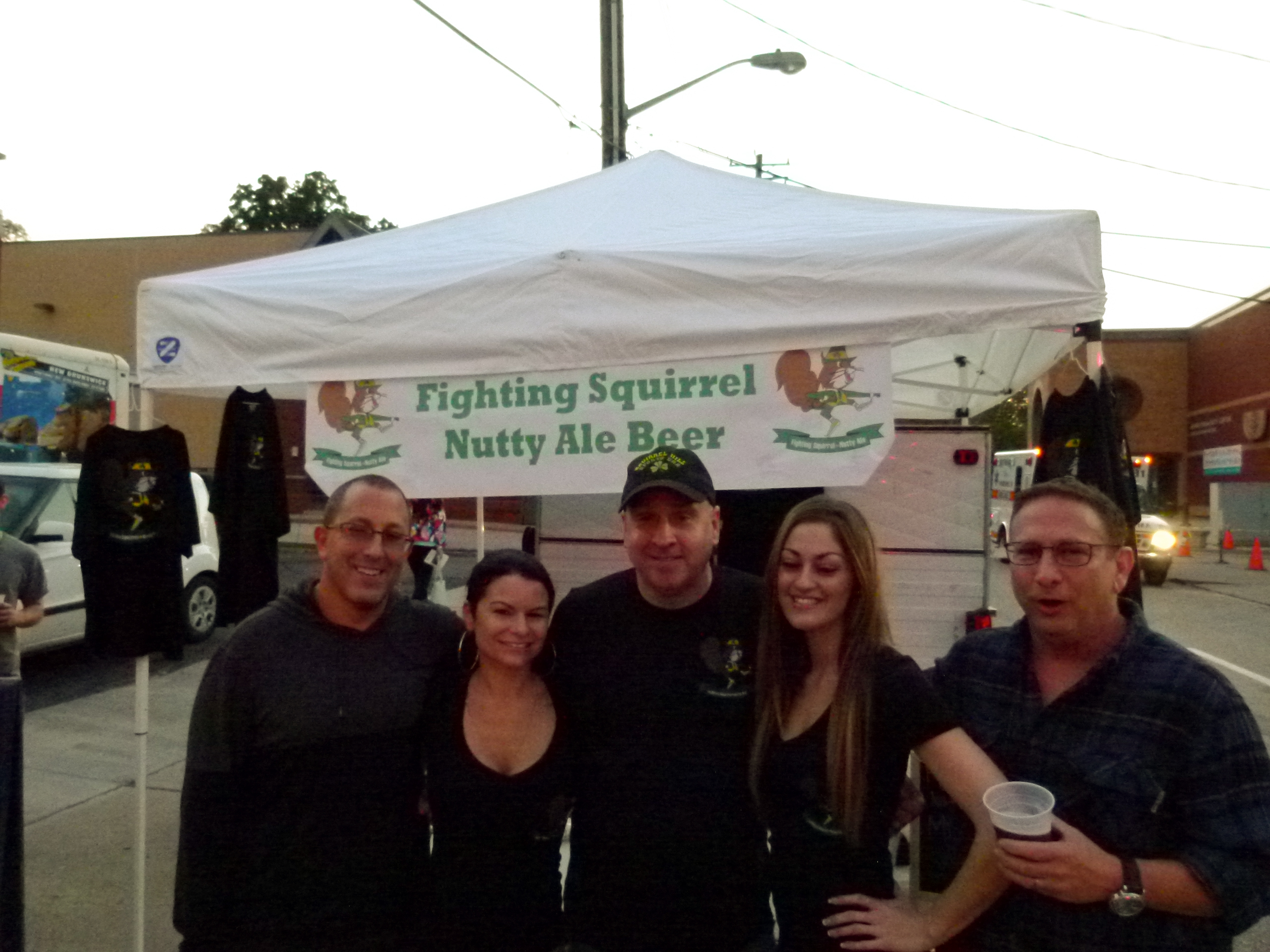 Squirrel Hill now has its own namesake beer, Fighting Squirrel Nutty Ale Beer. Brew owner, Barry White of the Squirrel Hill Sports Bar, seen here with his beer girls Jenn Niedermeyer (l.) and Amanda Coe (r.) and brother's Kenny Holtzman (l.) and Gregg Holtzman (r.)