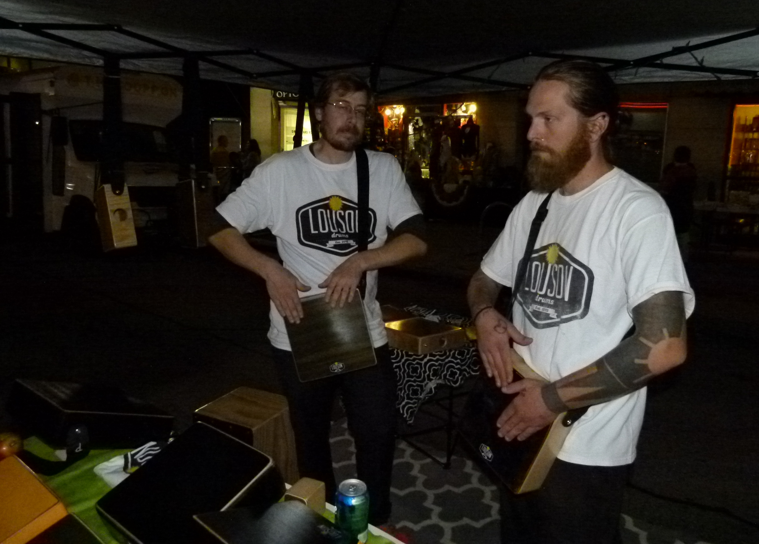 Carson Cashman (l.) and Lou Manione (r.) play cajon tablets. Their Louson CajonTabs are custom made and modeled on a Peruvian percussion instrument.