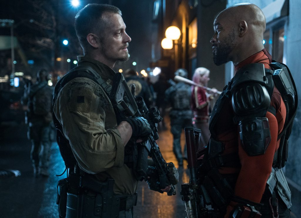 (L-r) Joel Kinnaman as Rick Flag and Will Smith as Deadshot have a little face-to-face chat. Photo Credit: Clay Enos/ TM & (c) DC Comics.