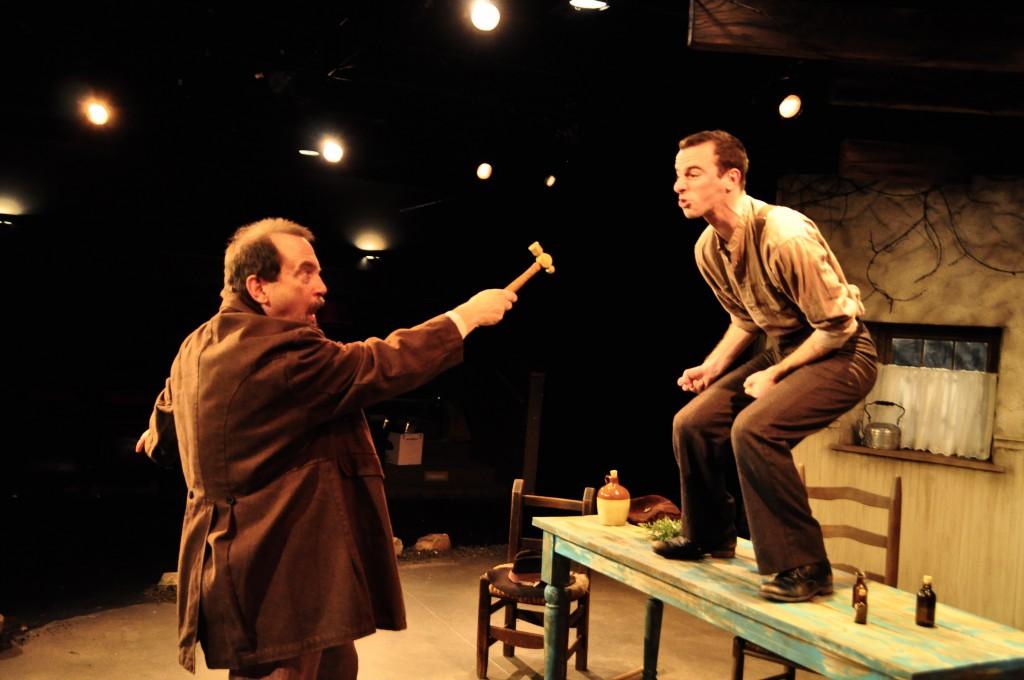 "Local medicine man Pats Bo Bwee (Martin Giles), left, tries to ""treat"" Neelus Conlee (Alec Silberblatt)."