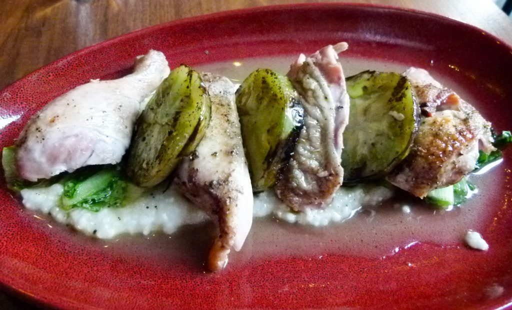 Wood roasted Gerber Farms chicken with grilled green tomatoes and polenta.