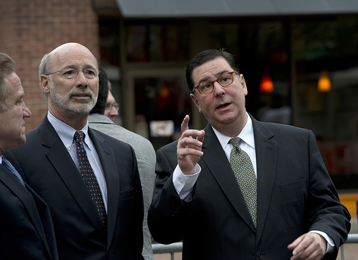 Mayor Bill Peduto (R) points out highlights in Pittsburgh's skyline to Pennsylvania Governor Tom Wolf at Earth Day opening ceremonies.