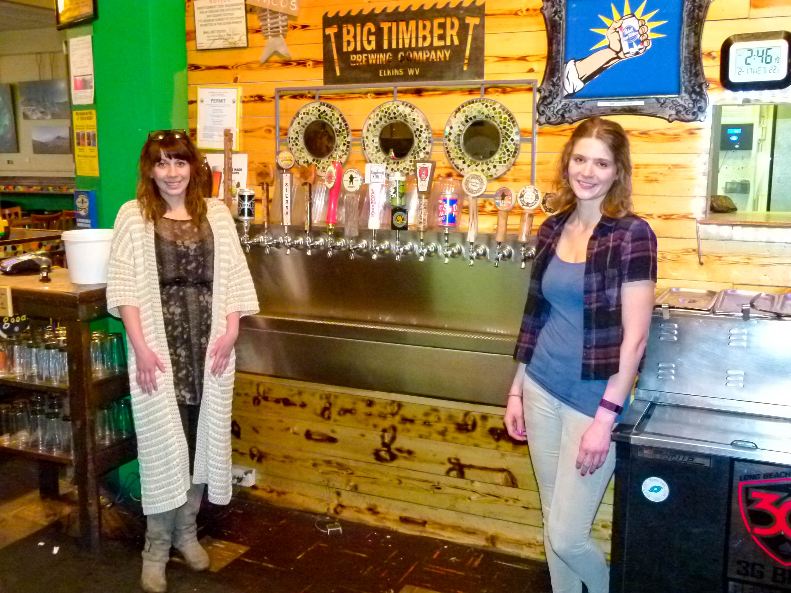 Amber (l.) and Carolyn (r.) frame the bar's wide selection of draft beers.