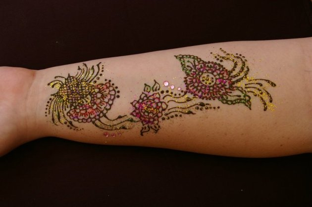 Drying flower henna tattoo with glitter