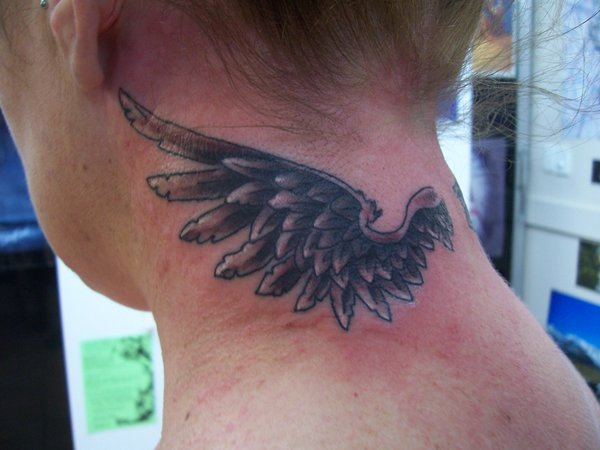 neck angel wing tattoo