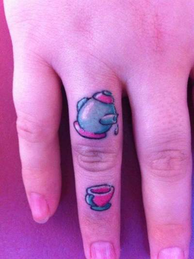 funny tattoo on finger 1