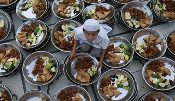 child prepares food for Iftar