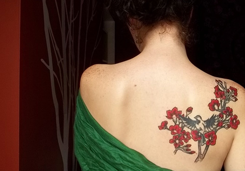 attractive bird tattoo on back