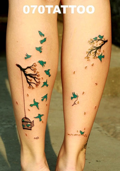 colorful small birds tattoo